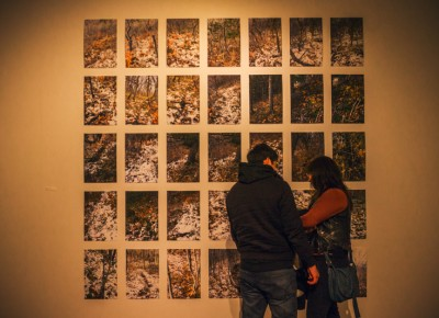 "A couple gets intimate as they cuddle up to Paul Crow's ""Trail Two, Autumn"" display. Photo: talynsherer.com"