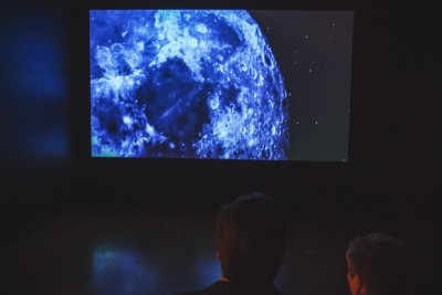 """We all stare in amazement as we are taken to space by artist Larissa Sansour's """"A Space Exodus"""" video. Photo: talynsherer.com"""