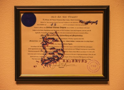 "A U.S. foreign policy document with the title ""Hold For Jon Stewart"" is perfectly framed among its brethren created by artist Dan Mills. Photo: talynsherer.com"