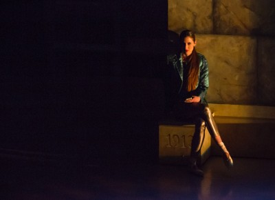 The performance opens up with a lone girl sitting against a wall, contemplating her next move. Photo: Talyn Sherer
