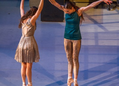 As we carry on, our two female dancers embrace one another. Photo: Talyn Sherer