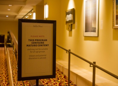 The parental advisory sign rests at the theatre entrance to forewarn all attendees. Photo: Talyn Sherer