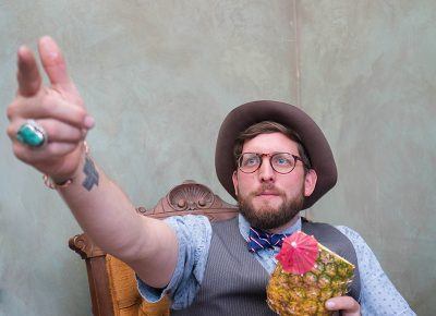 Portrait of Mister Pauper, Jake Buntjer from Provo, drinking a fancy pineapple beverage. Photo: JoSavagePhotography.com