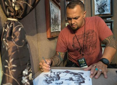 Murray-based artist Tai Taeoalli continues to create and draw with a ballpoint pen as people come in and admire his amazing art. Photo: JoSavagePhotography.com