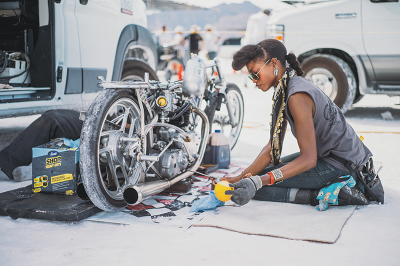 Jalika Gaskin of Alp Racing Design works on their record-breaking bike based on a 650cc 1950 Triumph engine. They beat the previous record of 133 mph in the 650 pushrod class with an average speed of 149 mph.