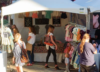 Shoppers browse Hum Stitchery's booth. The shop specializes in children's clothing. Photo: @snowlenda