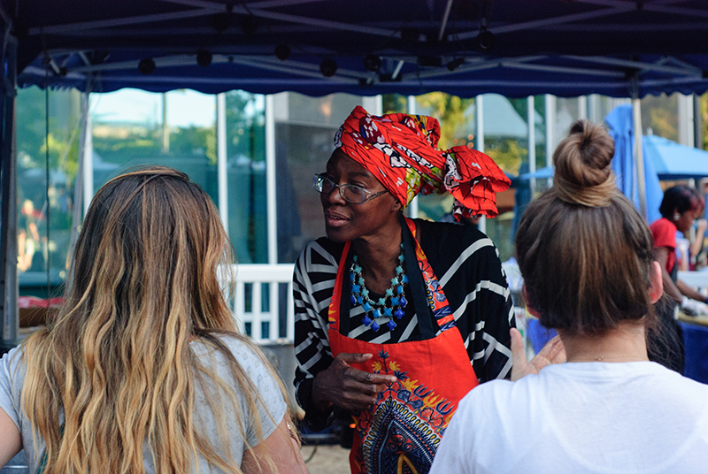 Cathy Tshilombo-Lokemba, of Mama Africa Grill, takes a customer's order at DIY Fest. Photo: @snowlenda