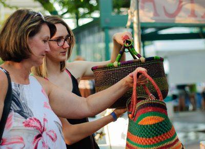 (L–R) Lisa and Savannah Manwill examine baskets at the Mama Africa craft booth. Photo: @snowlenda