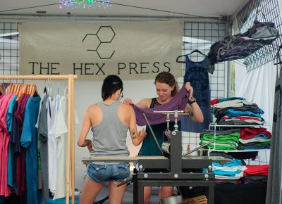 Makers at The Hex Press work on a design during DIY Fest. @snowlenda
