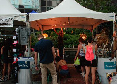 Makers hang lights as the sun sets over the DIY Fest. Photo: @snowlenda
