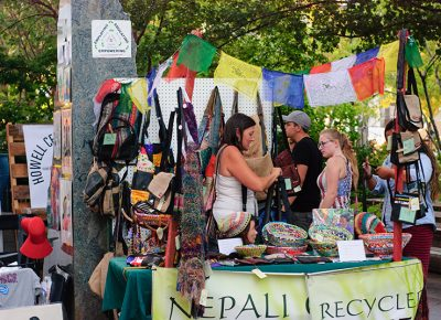 Anagela Chacon shows off goods from Beni Nepal. The items are made from recycled materials and imported from Nepal. Photo: @snowlenda