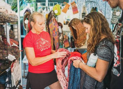Lynn Shell of Woolie Pig answering questions about their woolen goods. Photo: @clancycoop