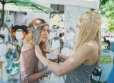 Mandy Williams (right) of Oculus Design helps an attendee try on one of her handmade headpieces. Photo: @clancycoop