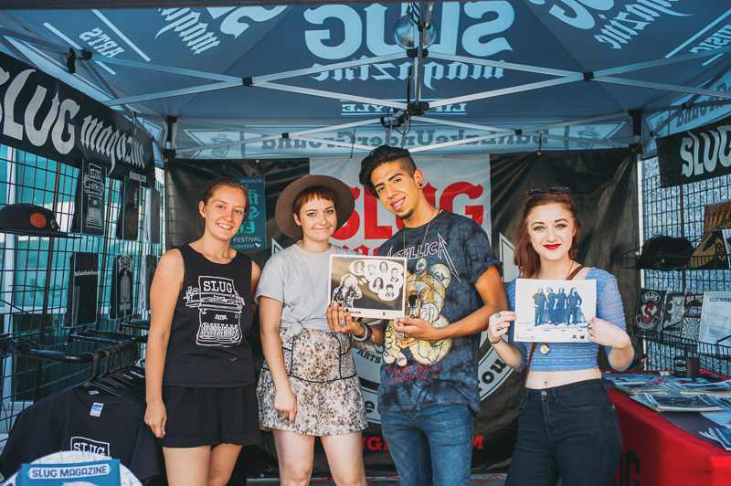 (L–R) SLUGgers Miriah Barkle and Aly Johnson were at the SLUG booth, where Jesus Rodriquez and Kat McComas came by to check out all the merch. Photo: @clancycoop