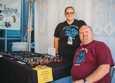 (L–R) Fiona and Mike Hurst show off their one-of-a-kind blown glass art pieces. Photo: @clancycoop