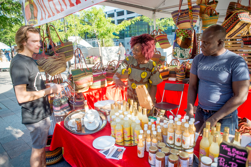 Cathy Tshilombo-Lokemba of Mama Africa explains her various hot sauces to a sold customer. Photo: @nellis_j