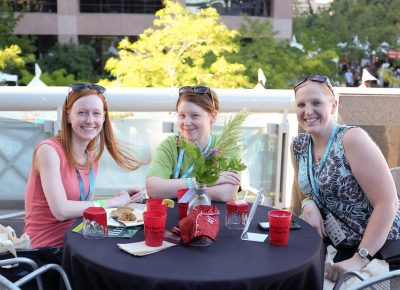 (L–R) Michelle, Stephanie, and Katie grab drinks on Craft Lake City's VIP patio. Photo: John Barkiple