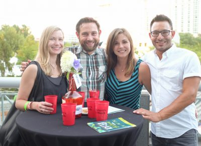 (L–R) Michelle Buhler, Nic Kanaanan, Kate Craft and Jeremey Rosen enjoy some Maker's Mark cocktails on Craft Lake City's VIP Patio. And for a look at Craft's craftiness, visit the glowsugar.com website to see her electro-luminescent clothing modifications. Photo: John Barkiple