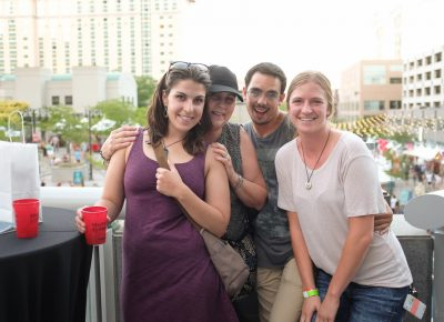 (L–R) Madison Denkers, Sue Denkers, J.D. and Mo snuggle up on the VIP Patio. Madison has loved the CLC DIY Festival for years, and she's thrilled to support local businesses. Photo: John Barkiple