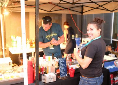 Uinta Brewing's Jamie Horton orders a drink from the CLC VIP bar. Photo: John Barkiple