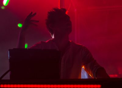 Immersed in the blood-red light, Flume moves with the music. Photo: Colton Marsala