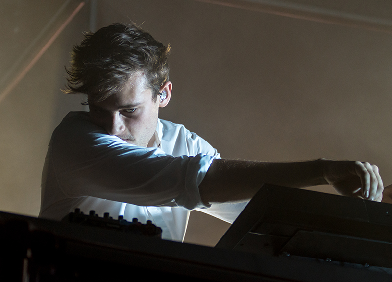 Flume studies his sound board, adjusting each element for a dynamic musical experience. Photo: Colton Marsala