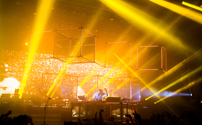 Doused in the golden shimmer of his light show, Flume envelops the crowd with both upbeat sound and angelic light. Photo: Colton Marsala