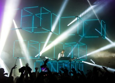 """The blue cubes, inspired by his """"infinity prism,"""" hover above Flume and the crowd, creating an energetic ambience. Photo: Colton Marsala"""