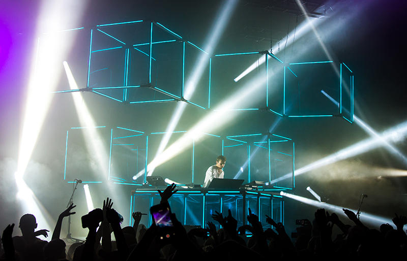 "The blue cubes, inspired by his ""infinity prism,"" hover above Flume and the crowd, creating an energetic ambience. Photo: Colton Marsala"
