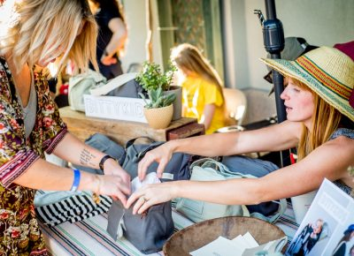 Holly Jo Hackett of Bitty Kids shows a customer the various features of her handmade bags, which are specially designed for parents who don't want to give up their lifestyle of adventure. Photo: @nellis_j