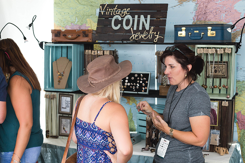 Kelly Annie of Kelly Annie Jewelry discussing her products with a DIY Fest-goer. Photo: @LMSorenson