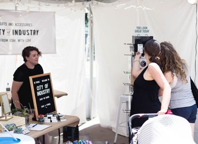 Folks checking out some stylish earrings at the City of Industry tent at the DIY Fest. Photo: @LMSorenson