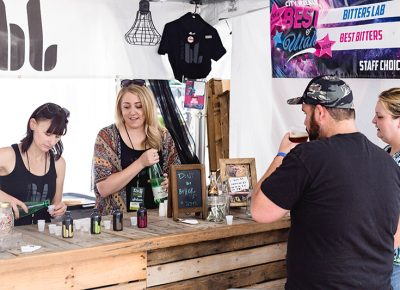 Guests sample some concoctions at the Bitters Lab tent. Photo: @LMSorenson