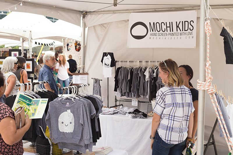 Mochi Kids clothing items being perused by guests of DIY Fest. Photo: @LMSorenson