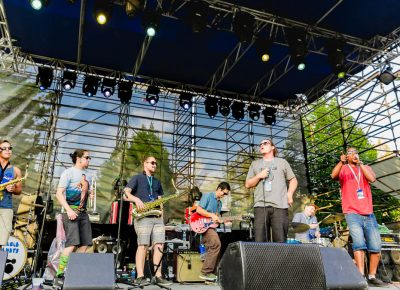 Grits Green onstage at the Twilight Concert Series. Photo: Logan Sorenson / @Lmsorenson