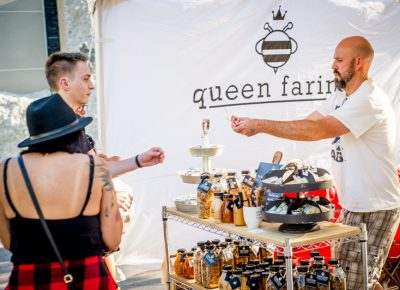 Samples of Queen Farina honey from Wellsville, Utah are handed out to eager festival-goers. Photo: @nellis_j
