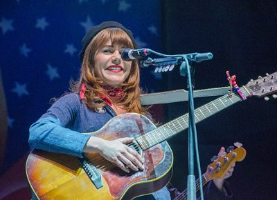 With a schoolgirl smile, Jenny performs for an appreciative crowd. Photo: Scott Frederick