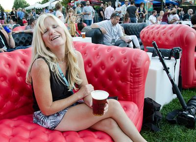 Lynette Mickelsen enjoys a beer in the VIP section before Jenny Lewis hits the stage. Photo: Scott Frederick