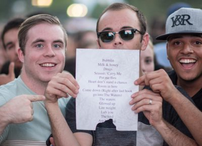 Lucky fans Dawson, Mason and Diogo were able to snag Anderson .Paak's set list. Photo: Colton Marsala