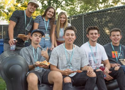 (Top L-R) Noah, Mandie, Melody, (Bottom L-R) Andrew, Ryan, Tanner, Adam hanging out in the Sponsor Lounge, enjoying fresh local pizza. Photo: Colton Marsala