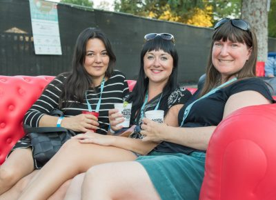 (L–R) Breanna, Randi, and Amy relax in the Sponsor's Lounge. Photo: Colton Marsala