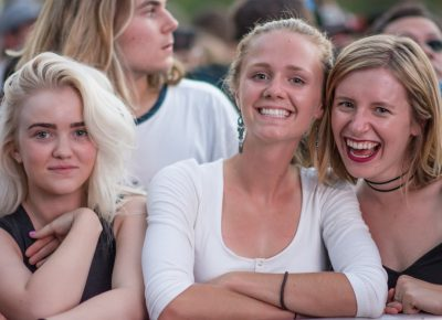 (L–R) Kennedi, Mia, and Malinna crowd the front of the stage, waiting for Big Grams to come on. Photo: Colton Marsala