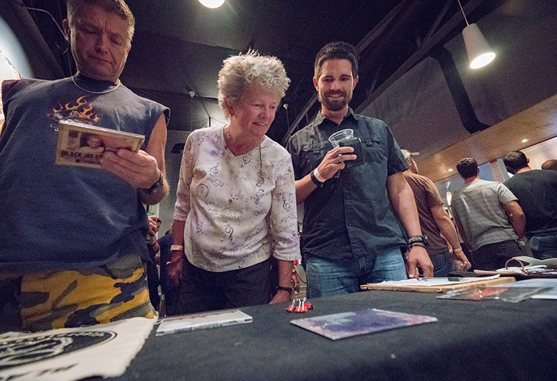 Attendees checked out the merch. Photo: JoSavagePhotography.com
