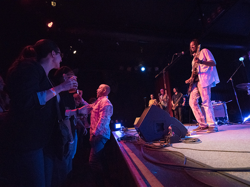 """Black Joe Lewis laughs during his performance as a guy takes a selfie of himself and BJL """"hanging out."""" Photo: JoSavagePhotography.com"""