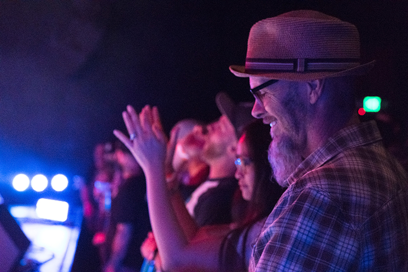 A crowd member has a genuine smile of happiness as he hears Black Joe Lewis and the Honeybears at The State Room. Photo: JoSavagePhotography.com