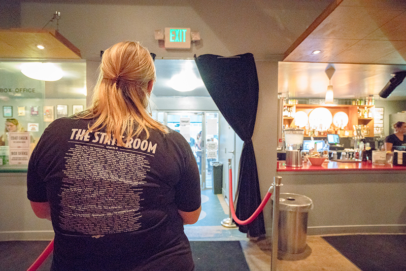 A State Room employee checks the early birds' IDs. Photo: JoSavagePhotography.com