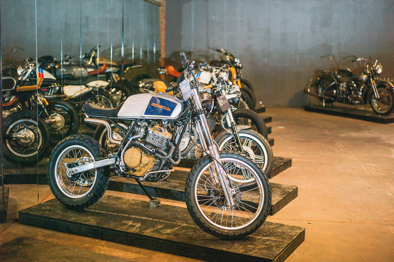 A lineup of diverse custom motorcycles in the invited builder room. Photo: @clancycoop