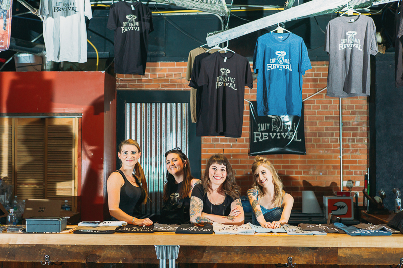 "(L–R) SBR volunteers Ana Mann, Sam ""Bronco"" Maclin, Raquel Baker and Annie Davis were at the merch booth slinging' SBR swag. Photo: @clancycoop"
