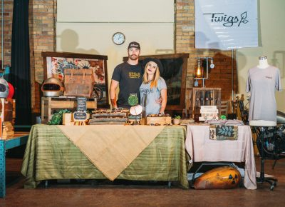 (L–R) Cade and Taelor Mangelson of Twigs Woodwear pose with their pop-up shop where they were selling their wooden watches and other nature-inspired accessories. Photo: @clancycoop