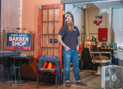 Nate Busch of Fuzzy Nates Barber Shop poses next to his pop-up shop, where he was busy offering cuts and shaves throughout the event. Photo: @clancycoop